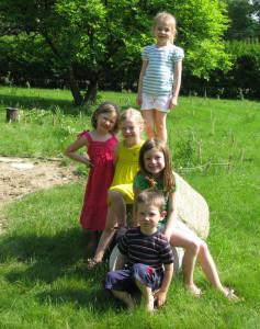 Kids outside on rock